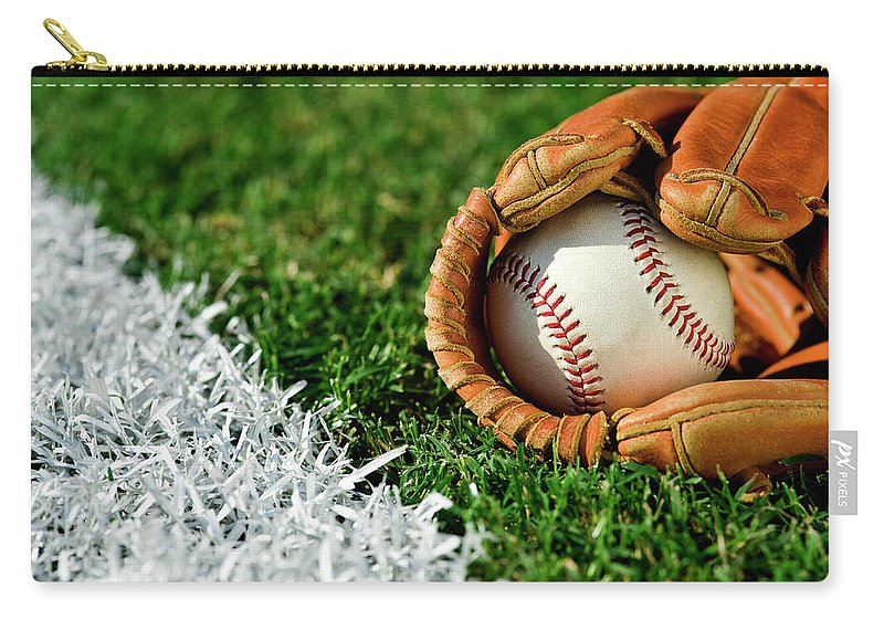 Grass Carry-all Pouch featuring the photograph New Baseball In Glove Along Foul Line by Cmannphoto