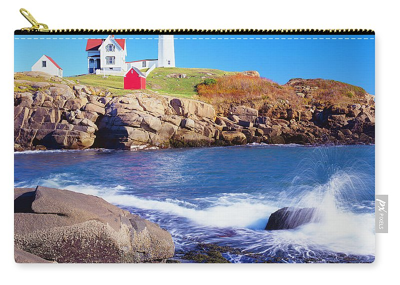 Water's Edge Carry-all Pouch featuring the photograph Nubble Lighthouse And Coastine Of Maine by Ron thomas
