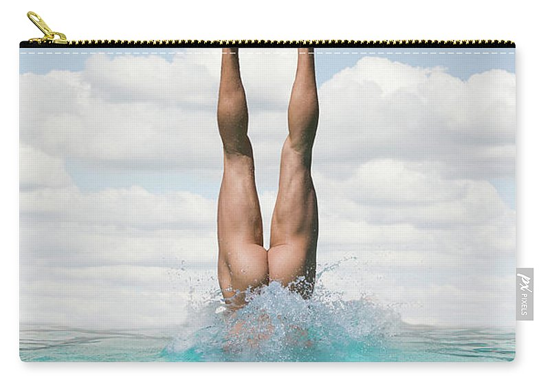 Diving Into Water Carry-all Pouch featuring the photograph Nude Man Diving by Ed Freeman
