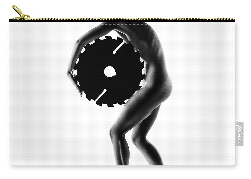 Woman Carry-all Pouch featuring the photograph Nude Woman With Saw Blade 1 by Johan Swanepoel