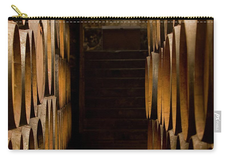 Alcohol Carry-all Pouch featuring the photograph Oak Barrels At The Wine Cellar by Kycstudio
