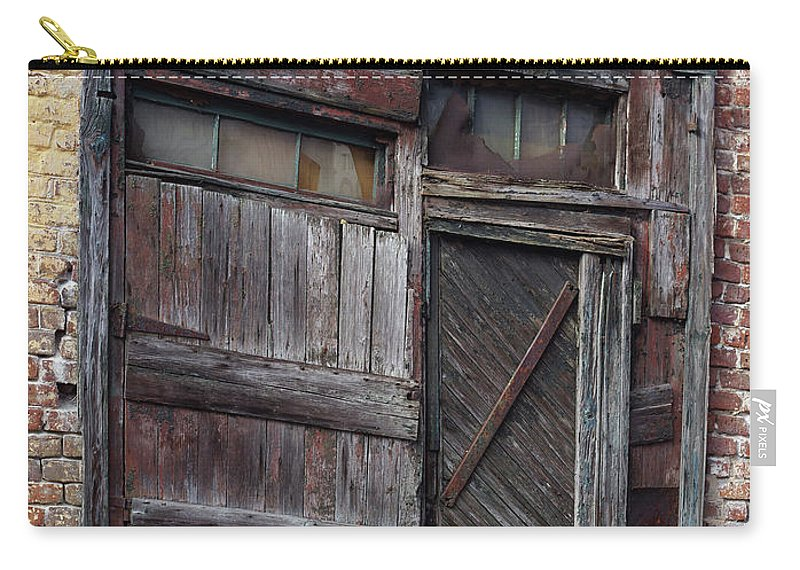 Old Door Carry-all Pouch featuring the photograph Oft Repaired Door by Michael Lempert