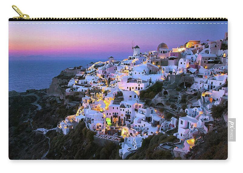Greek Culture Carry-all Pouch featuring the photograph Oia Lights At Sunset by Greg Gibb Photography