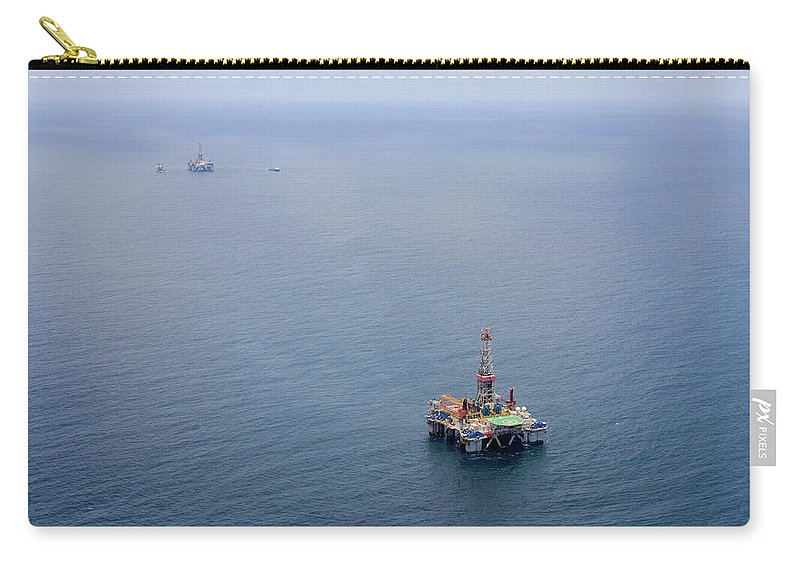 Convoy Carry-all Pouch featuring the photograph Oil Rigs by Heliry