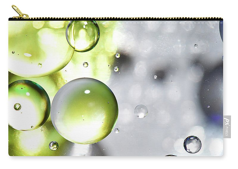 Mixing Carry-all Pouch featuring the photograph Oil Spheres by Dovate