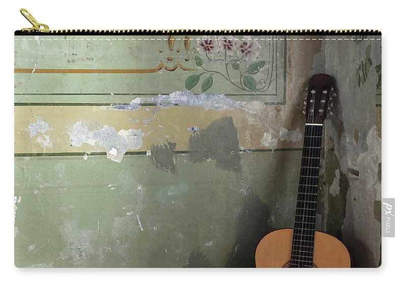 Music Carry-all Pouch featuring the photograph Old Guitar by Kursad