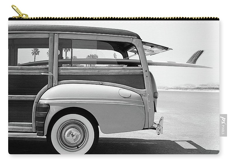 1950-1959 Carry-all Pouch featuring the photograph Old Woodie Station Wagon With Surfboard by Skodonnell