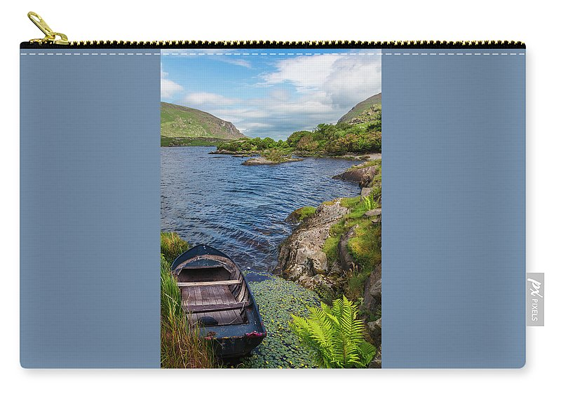 Boats Carry-all Pouch featuring the photograph On A Lake Of Blue by Debra and Dave Vanderlaan