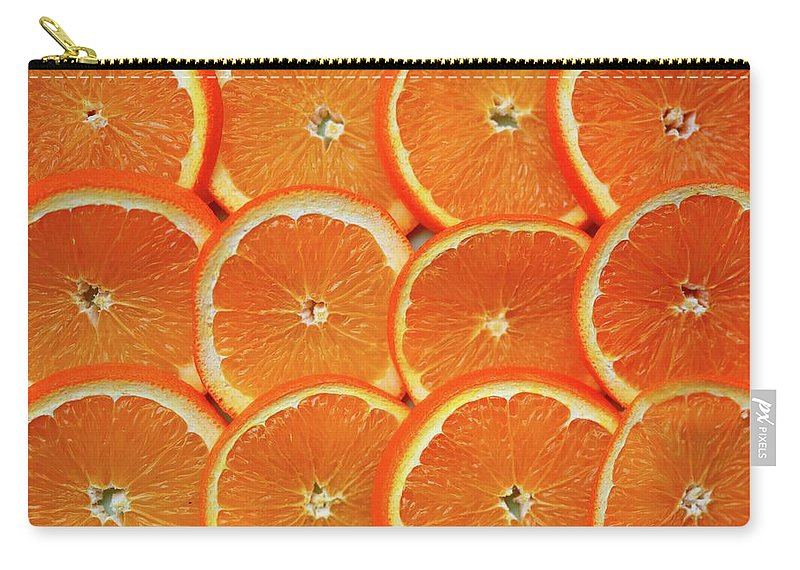 Orange Color Carry-all Pouch featuring the photograph Orange Fruit Slices by D. Sharon Pruitt Pink Sherbet Photography