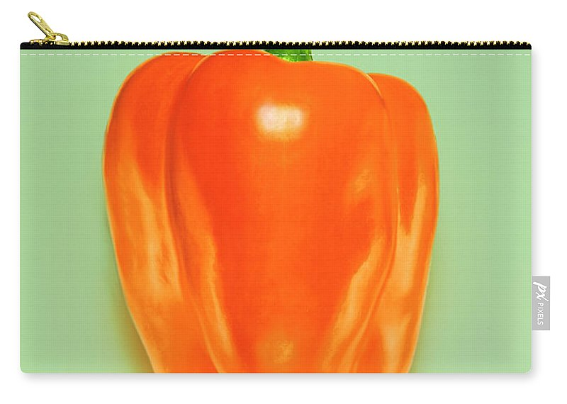 Orange Color Carry-all Pouch featuring the photograph Orange Pepper by Adrian Burke