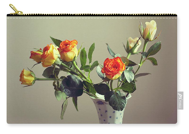 Orange Color Carry-all Pouch featuring the photograph Orange Roses In Vintage Vase by Copyright Anna Nemoy(xaomena)