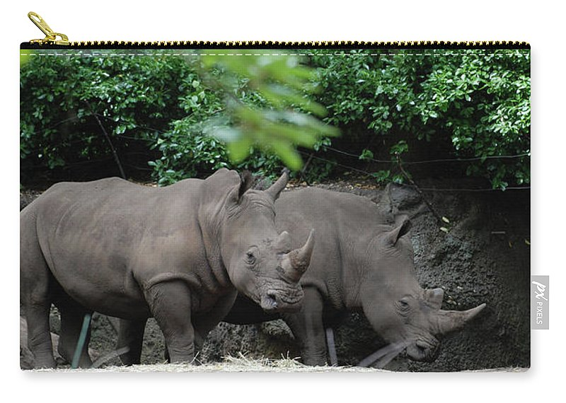 Rhino Carry-all Pouch featuring the photograph Pair Of Rhinos Standing In The Shade Of Trees by DejaVu Designs