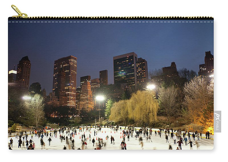 People Carry-all Pouch featuring the photograph Panorama Of People Ice Skating In by Studiokiet