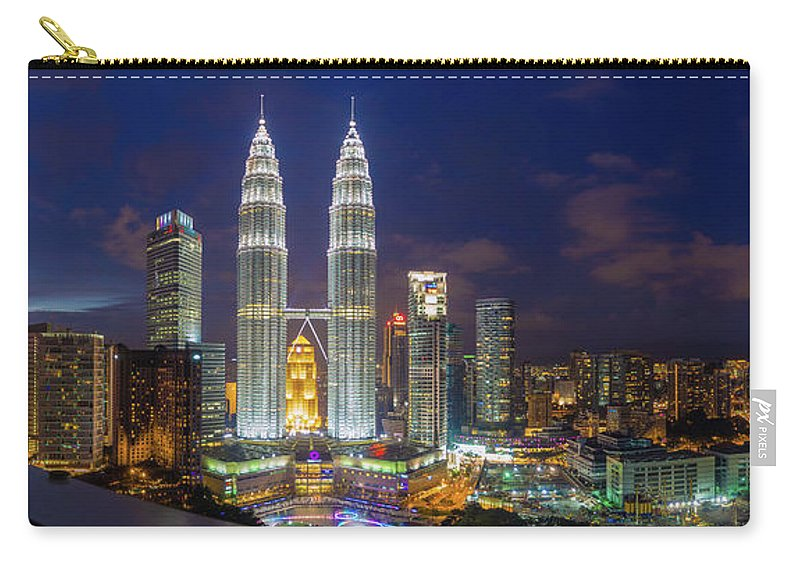 Panoramic Carry-all Pouch featuring the photograph Panoramic View Of Petronas Twin Towers by Www.imagesbyhafiz.com