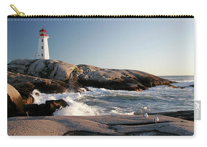 Water's Edge Carry-all Pouch featuring the photograph Peggys Cove Lighthouse & Waves by Cworthy