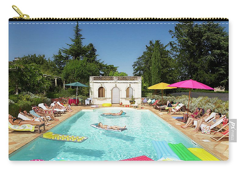 Young Men Carry-all Pouch featuring the photograph People Enjoying Summer Around The Pool by Ghislain & Marie David De Lossy