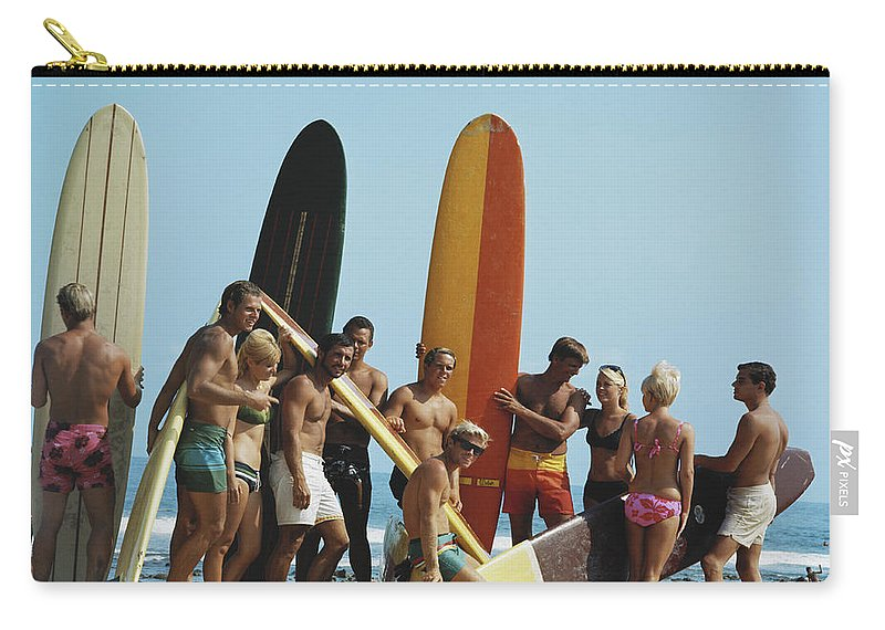 People Carry-all Pouch featuring the photograph People On Beach With Surf Board by Tom Kelley Archive