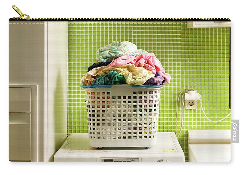 Washing Machine Carry-all Pouch featuring the photograph Pile Of Laundry On Washing Machine by Jae Rew