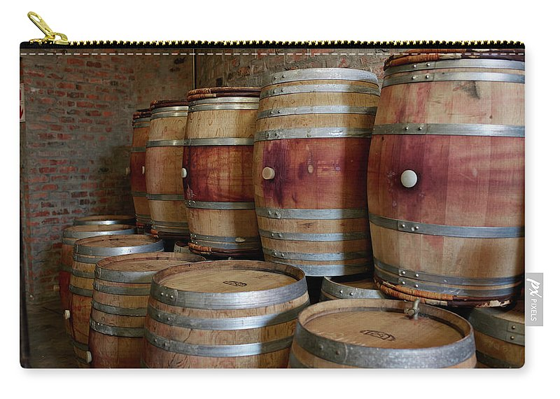 Stellenbosch Carry-all Pouch featuring the photograph Pile Of Wooden Barrels At Winery by Klaus Vedfelt