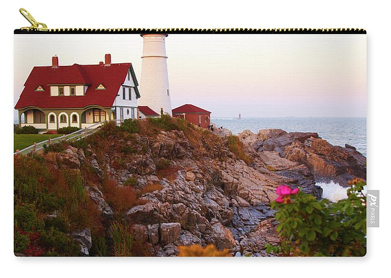 Clear Sky Carry-all Pouch featuring the photograph Portland Head Lighthouse At Susnet by Thomas Northcut