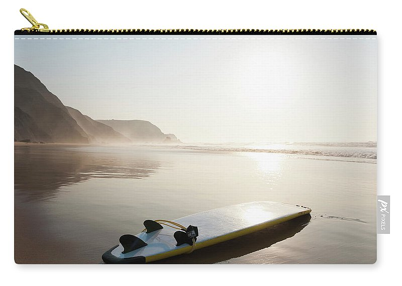 Algarve Carry-all Pouch featuring the photograph Portugal, Surfboard On Beach by Westend61