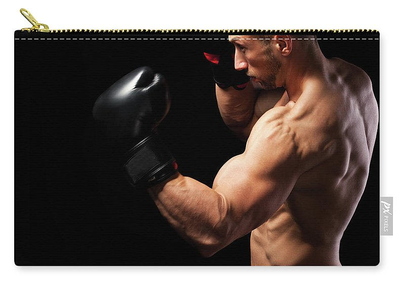 Toughness Carry-all Pouch featuring the photograph Powerful Punch by Momcilog