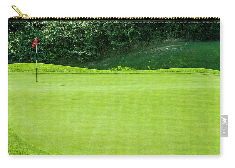 The End Carry-all Pouch featuring the photograph Putting Green And Flag At A Golf Course by Stuart Dee