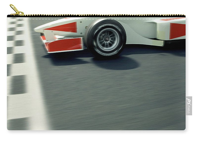 Aerodynamic Carry-all Pouch featuring the photograph Racing Driver Crossing Finishing Line by Alan Thornton