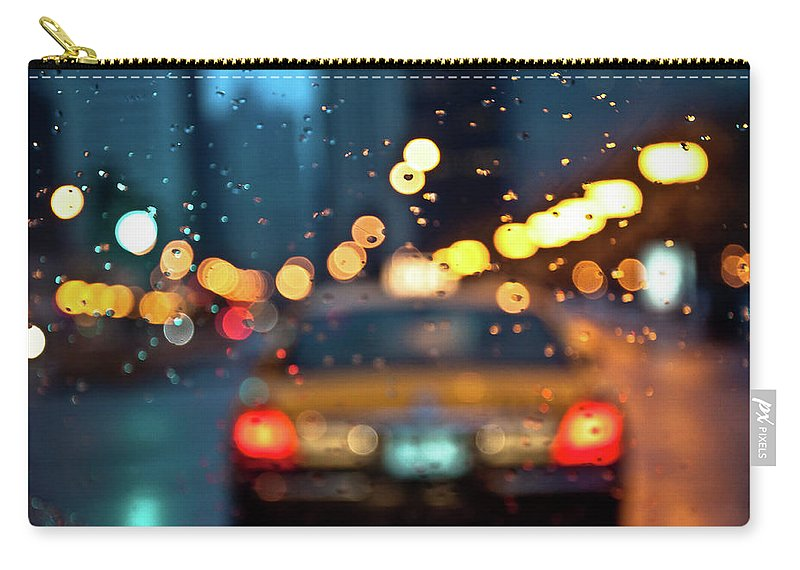 Car Interior Carry-all Pouch featuring the photograph Raw, Wet & Cold by Romeo Banias