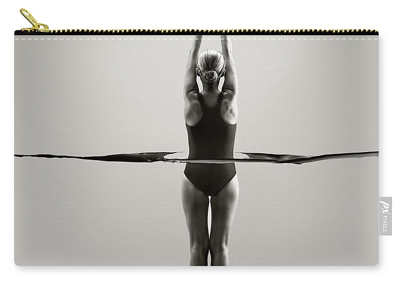 Diving Into Water Carry-all Pouch featuring the photograph Rear View Of Female Swimmer by Jonathan Knowles