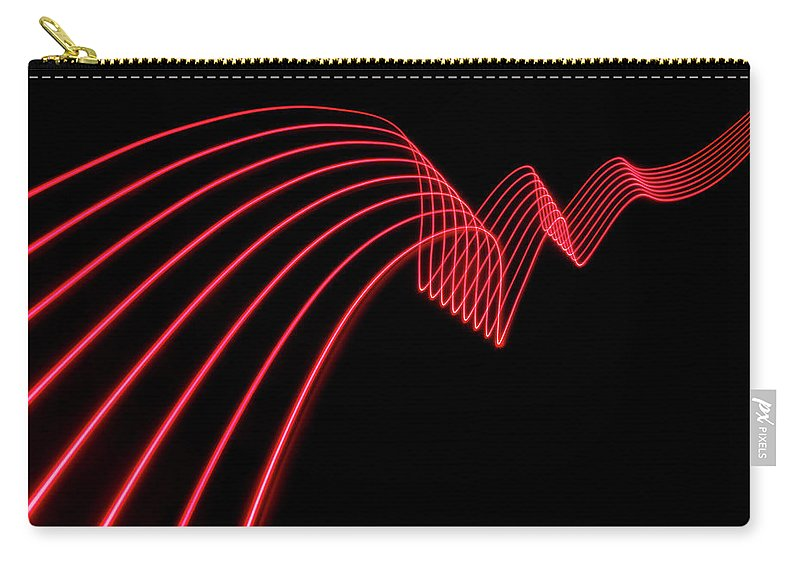 Laser Carry-all Pouch featuring the photograph Red Abstract Coloured Lights Trails And by John Rensten