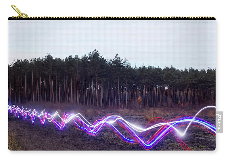 Internet Carry-all Pouch featuring the photograph Red, Blue And White Light Trails On by Tim Robberts