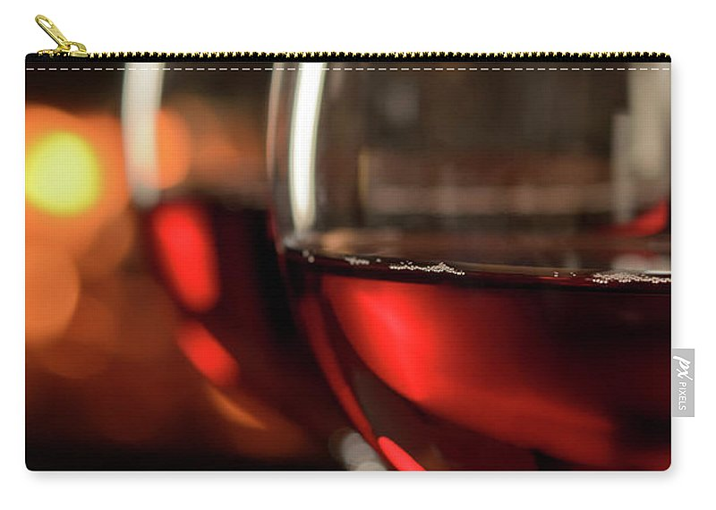 Orange Color Carry-all Pouch featuring the photograph Red Wine By The Fire by Nightanddayimages