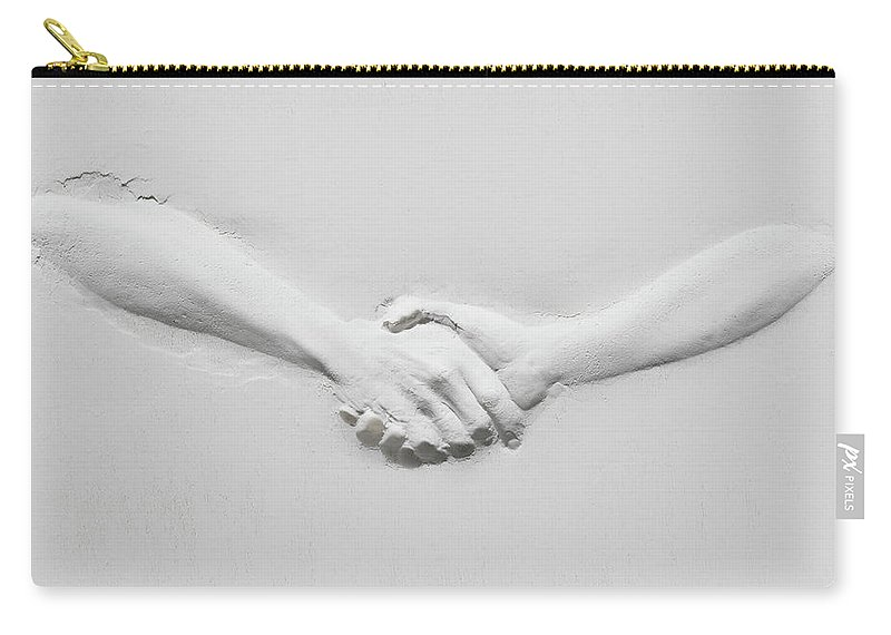 Human Arm Carry-all Pouch featuring the photograph Relief Of Handshake by Henrik Sorensen