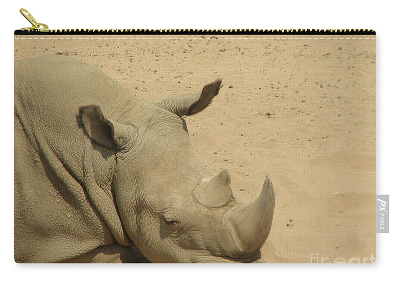 Rhino Carry-all Pouch featuring the photograph Resting Rhinoceros With His Head Down In A Sandy Area by DejaVu Designs