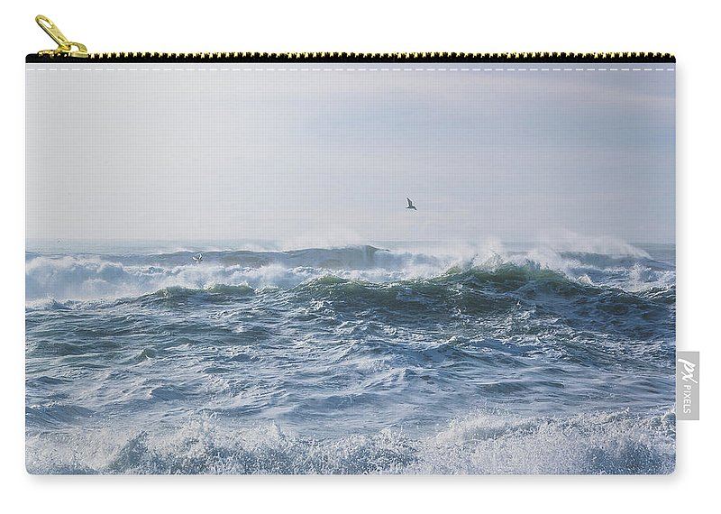 Angry Ocean Carry-all Pouch featuring the photograph Reynisfjara Seagull Over Crashing Waves by Nathan Bush