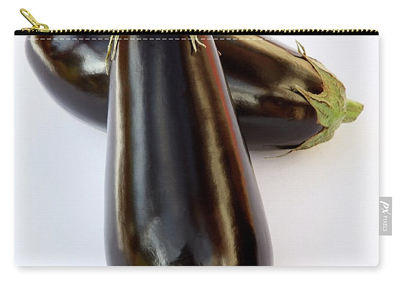 White Background Carry-all Pouch featuring the photograph Ripe, Organic Aubergines On White by Rosemary Calvert