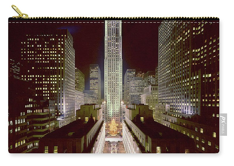 1980-1989 Carry-all Pouch featuring the photograph Rockefeller Center, Manhatten, At by Thorney Lieberman