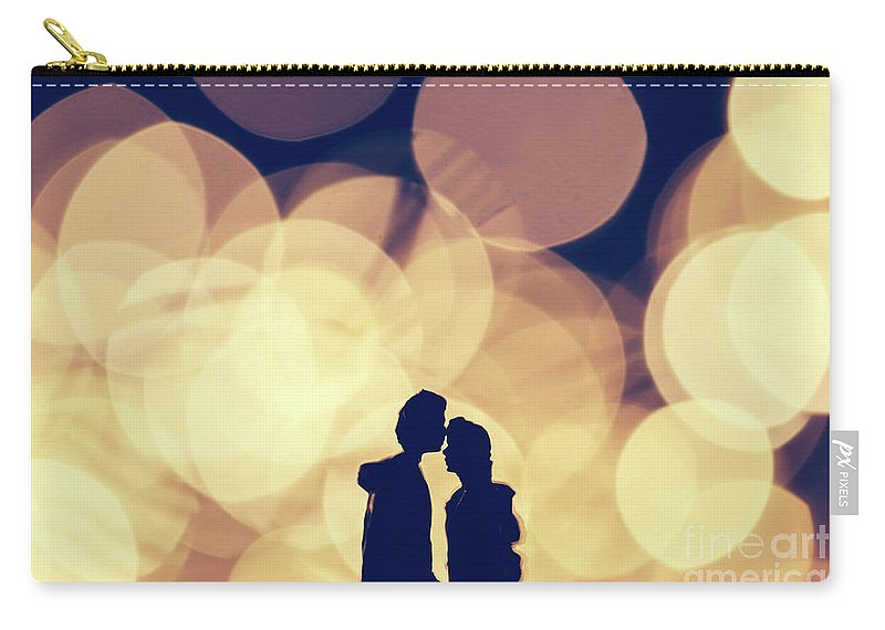 Man Carry-all Pouch featuring the photograph Romantic Couple Kissing On Illuminated Background. by Michal Bednarek