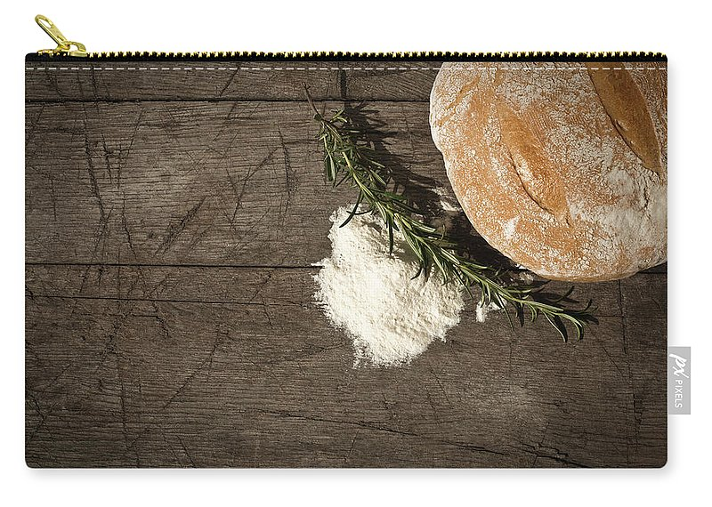 Bakery Carry-all Pouch featuring the photograph Round Bread On A Wooden Table by Infrontphoto