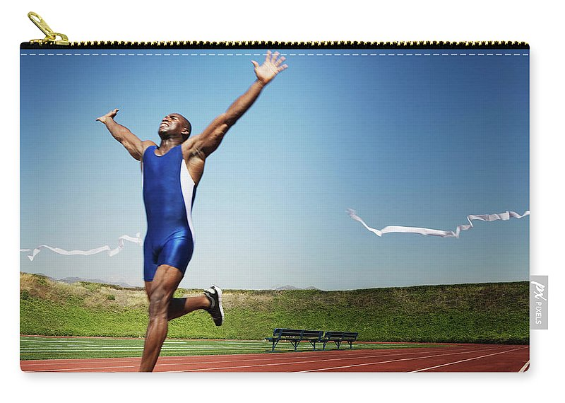 Human Arm Carry-all Pouch featuring the photograph Runner Crossing Finish Line by Jupiterimages