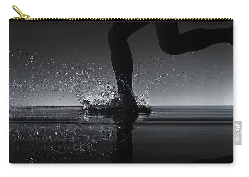 Recreational Pursuit Carry-all Pouch featuring the photograph Running Through Water by Jonathan Knowles