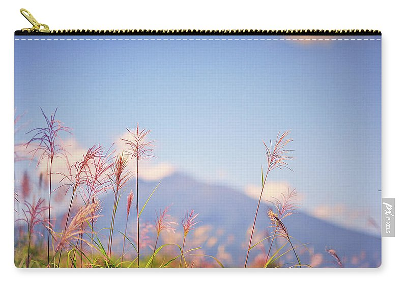 Scenics Carry-all Pouch featuring the photograph Rushes by Photo By Glenn Waters In Japan