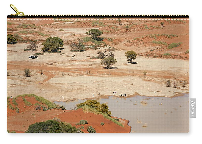 Namibia Carry-all Pouch featuring the photograph Safari Tourists By Sossusvlei Pan by Bjarte Rettedal
