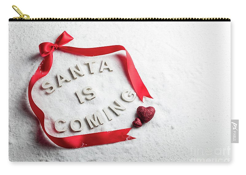 Christmas Carry-all Pouch featuring the photograph Santa Is Coming Text And Red Ribbon by Michal Bednarek