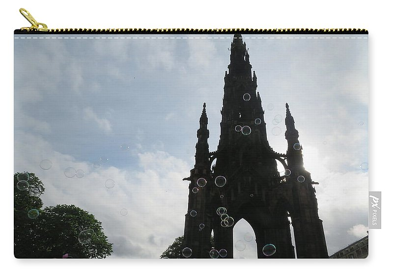 Scott Monument Carry-all Pouch featuring the photograph Scott Monument In Edinburgh With Soap Bubbles by Ranim Asfahani