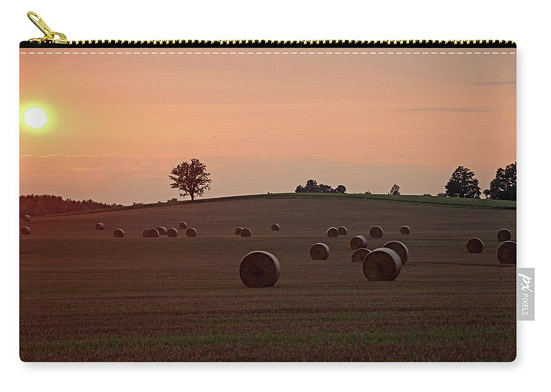 Hay Carry-all Pouch featuring the photograph Setting Sun And Hay Bales by Debbie Oppermann