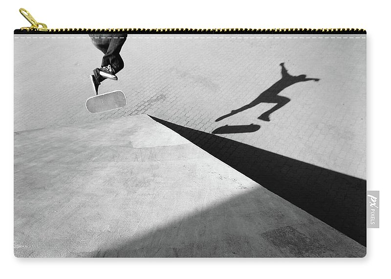 Shadow Carry-all Pouch featuring the photograph Shadow Of Skateboarder by Mgs