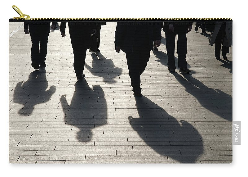 Shadow Carry-all Pouch featuring the photograph Shadow Team Of Commuters Walking On by Peskymonkey