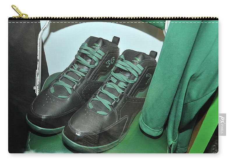 Sports Carry-all Pouch featuring the photograph Shaq's Size 23 Shoes by Mike Martin